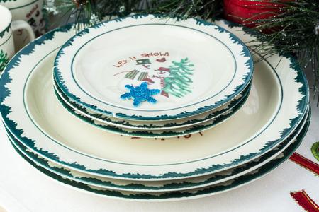 Close up of Christmas decorative dinner set and table with Christmas decorations. photo & Close Up Of Christmas Decorative Dinner Plates Dessert Plates ...