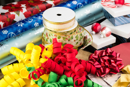 Close up of Christmas ribbons, Chrismas wrapping paper, burlap gift bags, candy box. Reklamní fotografie