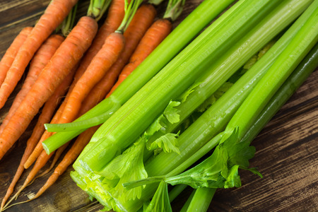 Close up of carrots, celery - ingredients for minestrone soup.