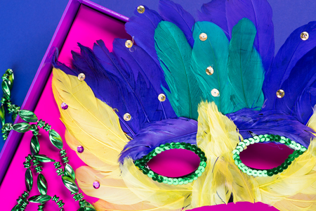 mardigras: Close up of mardigras mask in the pink box on the blue background. Stock Photo