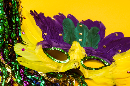 mardigras: Close up of mardigras mask on yellow background.