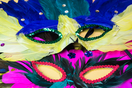 mardigras: Close up of mardigras masks on yellow background. Stock Photo
