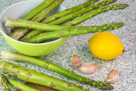 Close up of fresh organic asparagus spears on cutting board. Stock Photo