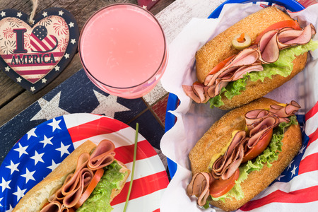 forth: Close up of  fresh homemade ham sandwiches on party table for Forth of July celebration.