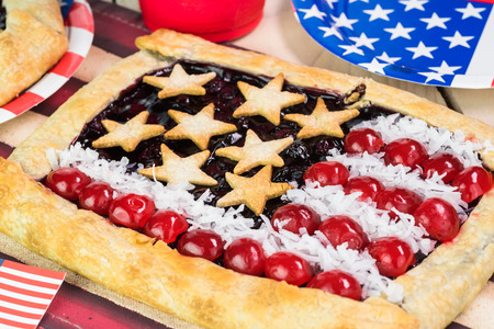 forth: Close up of decorated table  for Forth of July celebration with homemade blueberry pies.