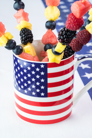 forth: Close up of fruit and berry sticks in the mug for celebration Forth of July.
