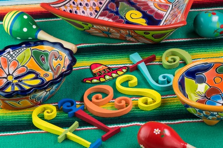 Close Up Of Fiesta Table Decorated With Colorful Letters, Bright Pottery  And Mexican Table Runner