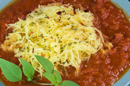 marinara sauce: Top view of plate with roasted spaghetti squash and marinara sauce.