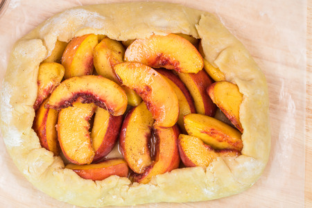 Close up of unbaked spiced peach galette - ready to oven.