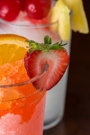 bahama: Close up of glass of frozen pina colada cocktail and bahama mama on bar table.
