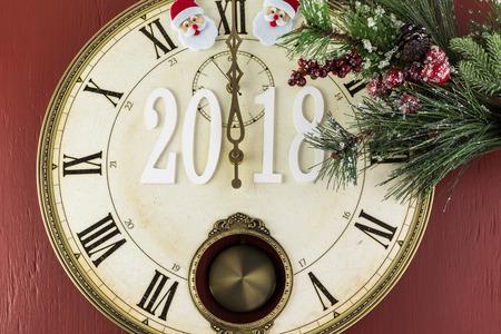 anticipation: Anticipation of 2018 New Year celebration. Clock shows midnight. Stock Photo