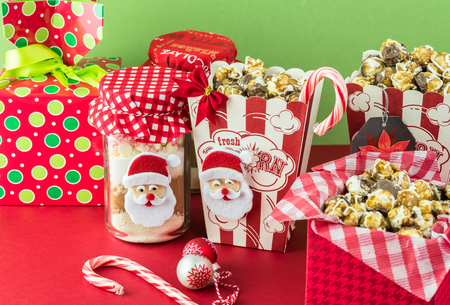 cocoa mix jars and caramel popcorn boxes decorated for christmas gifts stock photo 66011847