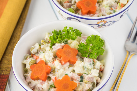 Close up of bowls with traditional russian olivier salad. Stok Fotoğraf