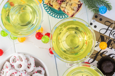 Top view of glasses with homemade limoncello on a table decorated for New Year party. Stock Photo