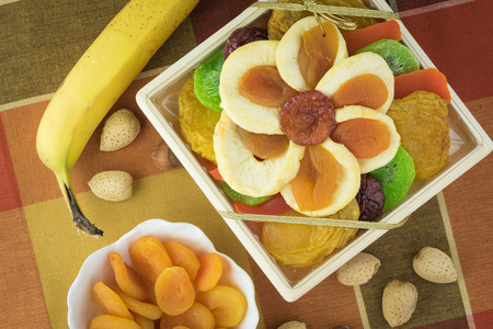 Close up of plate with assorted dried fruits. Holiday gift. Banco de Imagens