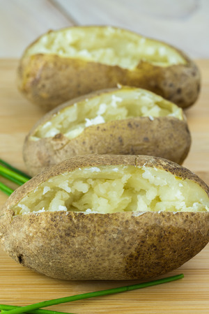 Close up of  baked potatoes - ready for loaded.