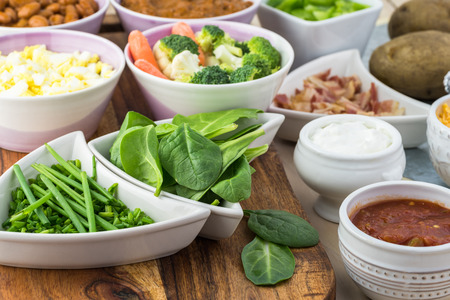 Close up of ingredients for loaded baked potatoes. Stock Photo
