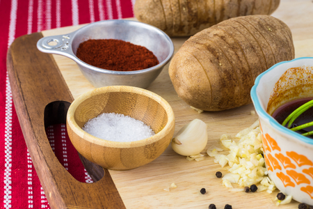 russet potato: Close up of hasselbacked potatoes, smoked paprika oil - ingredients for hasselback potatoes.