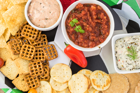 Top view of party tray for soccer game with variety of snacks and dips on the tray. Stock Photo