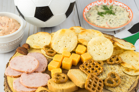 close up of party table with variety of snacks and dips for soccer