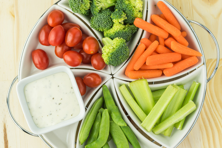 dipping: Top view of tray with healthy vegetable snacks.
