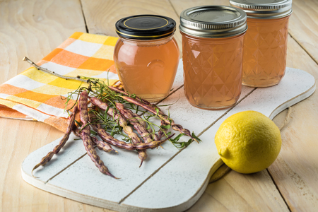 Close up of jars with homemade delicious mesquite bean jelly. Stock Photo