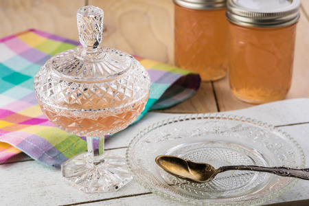 Close up of dessert glass with homemade delicious mesquite bean jelly.