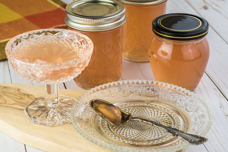 Close up of dessert glass and jars with homemade delicious mesquite bean jelly. Stock Photo