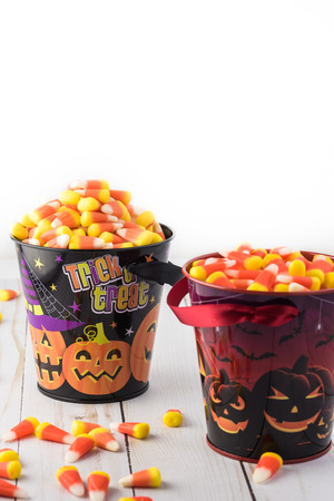 Close up of halloween buckets with candy corn. Stock Photo