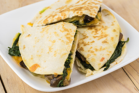 gallo: Close up of white plate with spinach mushroom quesadillas. Stock Photo