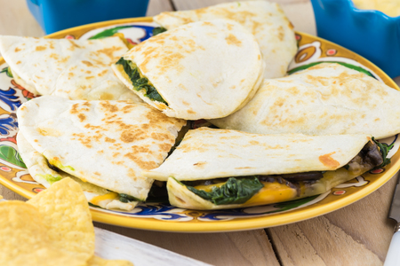 gallo: Close up of plate with spinach mushroom quesadillas.