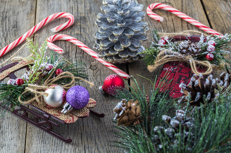 Close up of decorative Christmas sleds on a rustic wooden. Stok Fotoğraf