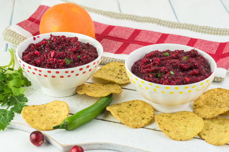 Close up of bowls with fresh homemade cranberry salsa. Stock Photo