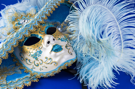 Close up of carnival beautiful venetian mask on dark blue background.