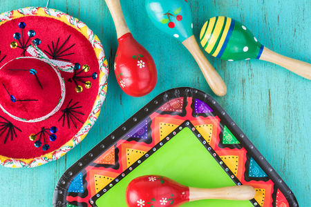 Cinco De Mayo bright background with  sombrero and maracas.