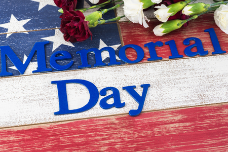 Memorial day greeting card with american flag and flowers.