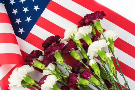 Memorial day greeting card with american flag and flowers. Stock Photo