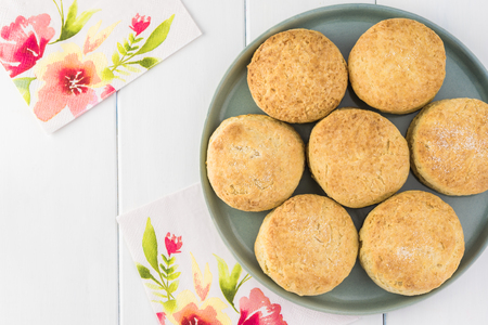 Top view of homemade baked round scones on a plate. Stok Fotoğraf
