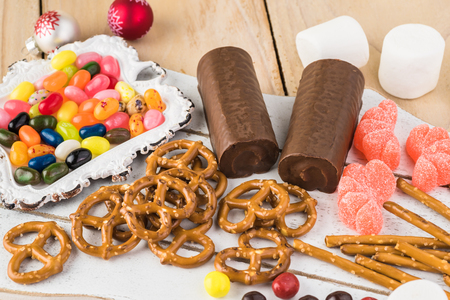 Candies, mini and sticks pretzels, swiss rolls, marshmallows - ingredients for crafting of sweet candy deer.