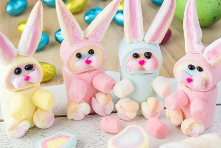 Rainbow marshmallow bunnies for Easter cupcake. Stock Photo