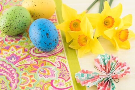 Easter greeting card concept with colorful eggs and spring flowers. Stock Photo