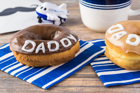 Greeting with donuts and a cup of coffee for Fathers Day from chiidren.
