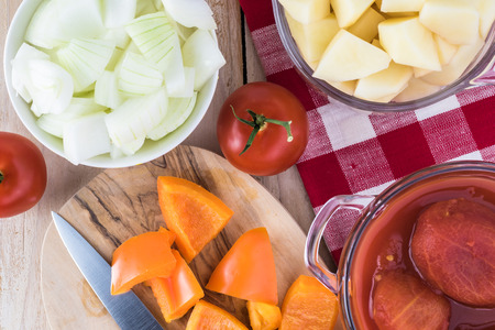 Ingredients for hungarian soup goulash: cut potatoes, bell pepper, carrot, peeled tomatoes in tomato juice.