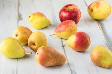 Close up of colorful ripe pears on wooden background. Stock Photo