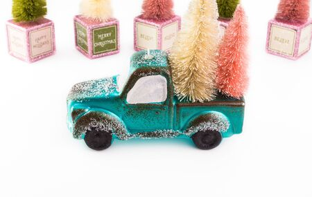 Christmas decoration with toy retro truck and Christmas trees on a white background. Greeting card consept. Stock Photo