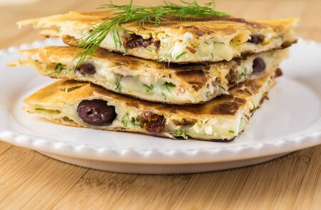 Fried quesadillas on a plate. Imagens