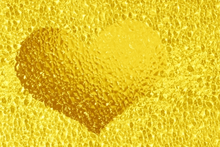 closeup shot of colorful golden crystal heart photo