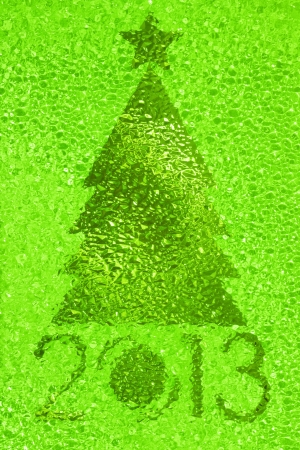 Closeup shot of Christmas tree crystal green background photo