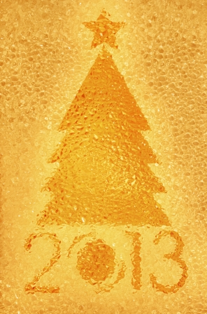 Closeup shot of Christmas tree crystal golden background photo