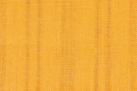 Close up shot of yellow seamless fabric texture photo